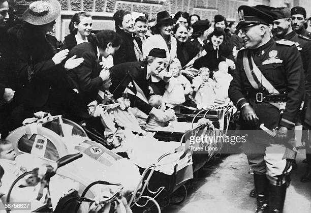 Italian fascist dictator Benito Mussolini meets an enthusiastic group of mothers and their babies in Turin circa 1940