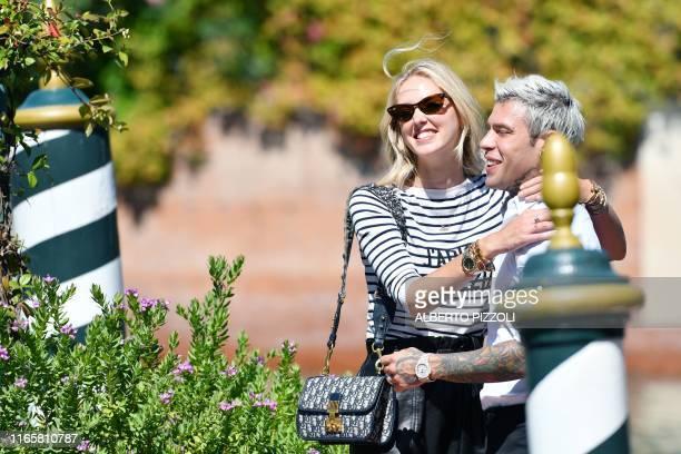 Italian fashion blogger and designer Chiara Ferragni embraces her husband Italian rapper Federico Leonardo Lucia aka Fedez upon their arrival at the...