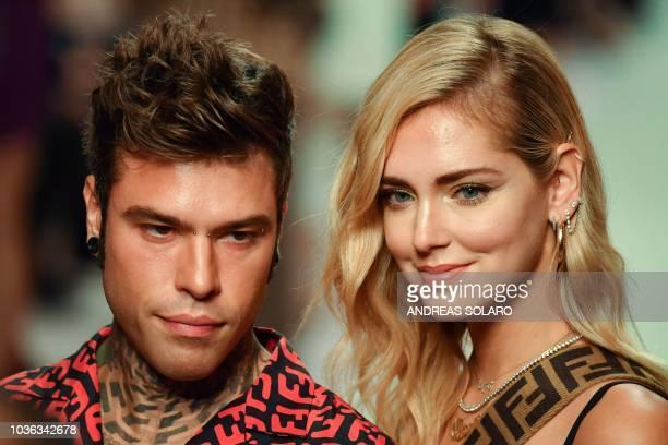 Italian fashion blogger Chiara Ferragni and her husband Italian rap singer Fedez attend the presentation of the Fendi fashion house collection during...