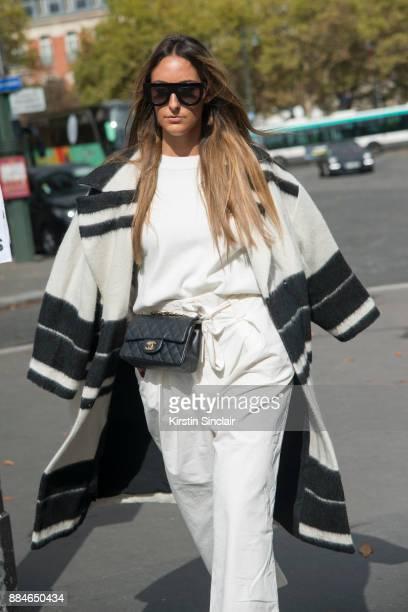Italian fashion blogger Elisa Taviti wears a Vintage coat Celine sunglasses Zara trousers Chanel bag day 5 of Paris Womens Fashion Week Spring/Summer...