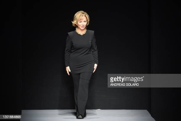 Italian fashion designer Alberta Ferretti acknowledges applause after the presentation of her Women's Fall Winter 2020 collection on February 19 2020...