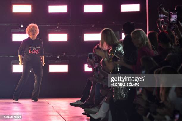 Italian fashion designer Alberta Ferretti acknowledges applause following the presentation of her Women's Spring/Summer 2019 fashion show in Milan on...