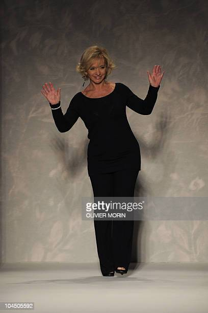 Italian fashion designer Alberta Ferretti acknowledges the audience at the end of her springsummer 2011 readytowear collection on September 22 2010...
