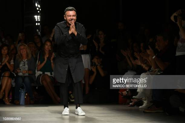 Italian fashion designer Alberto Zambelli acknowledges applause following the presentation of his Women's Spring/Summer 2019 fashion collection in...