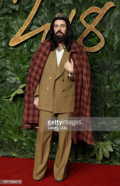 Italian fashion designer Alessandro Michele poses on the red carpet upon arrival to attend the British Fashion Awards 2018 in London on December 10...