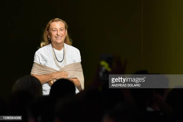 Italian fashion designer and businesswoman, Miuccia Prada acknowledges applause following the presentation of the Prada fashion collection during the...