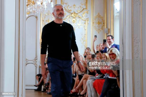 Italian fashion designer Antonio Grimaldi acknowledges the audience at the end of his during the 20182019 Fall/Winter Haute Couture collection...