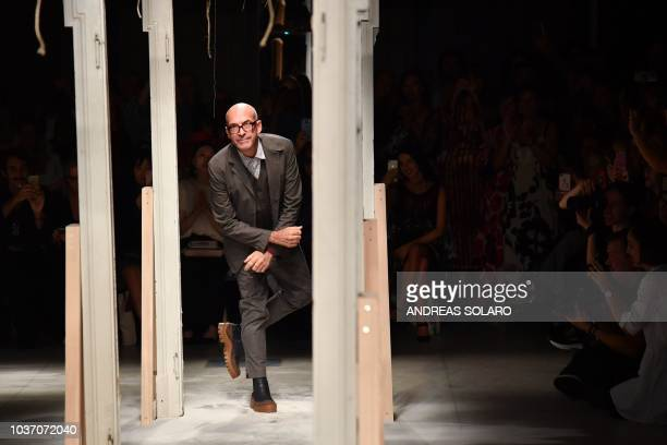 Italian fashion designer Antonio Marras acknowledges applause following the presentation of the Marras fashion house collection as part of the...