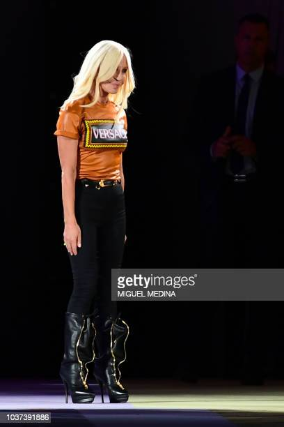 Italian fashion designer Donatella Versace acknowledges applause following the presentation of the Versace fashion show during the Women's...