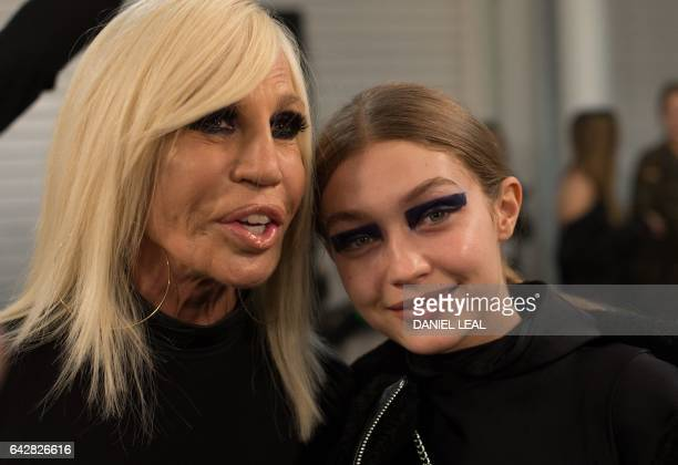 Italian fashion designer Donatella Versace and US model Gigi Hadid pose backstage before the Versus catwalk show on the second day of the...