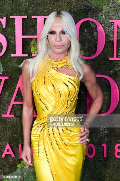 Italian fashion designer Donatella Versace poses as she arrives to attend the Green Carpet Fashion Awards 2018 within the Women's Spring/Summer 2019...