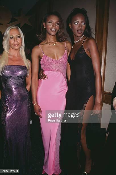 Italian fashion designer Donatella Versace , Valerie Morris , and English model Naomi Campbell attend the Michael Awards at the Hilton Hotel, New...
