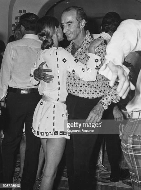 Italian fashion designer Emilio Pucci pictured dancing with a woman at the Mare Moda fashion event in Capri September 5th 1967