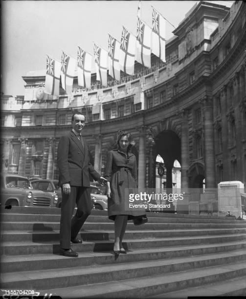 Italian fashion designer Emilio Pucci with his wife, Cristina on The Mall, London, 21st May 1959. Behind them is Admiralty Arch.
