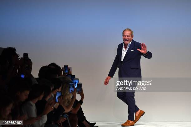 Italian fashion designer Ermanno Scervino acknowledges applause following the presentation of his Women's Spring/Summer 2019 fashion show in Milan on...