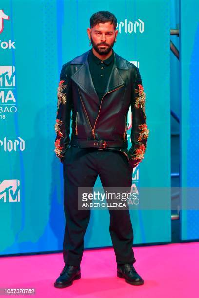 Italian fashion designer Fausto Puglisi poses on the red carpet ahead of the MTV Europe Music Awards at the Bizkaia Arena in the northern Spanish...