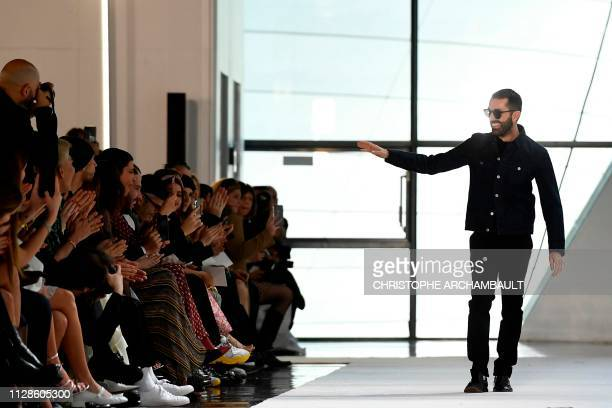 Italian fashion designer Giambattista Valli acknowledges the audience at the end of the Gambattista Valli Fall-Winter 2019/2020 Ready-to-Wear...