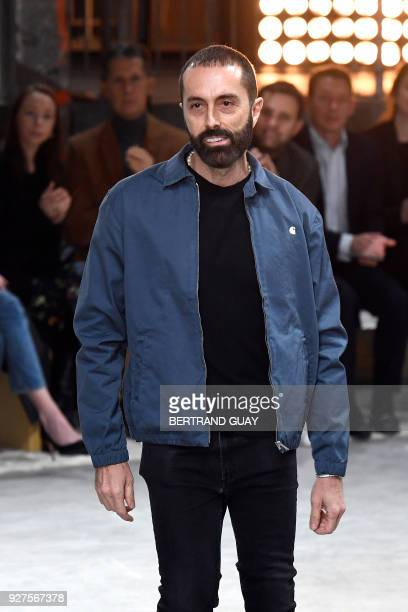 Italian fashion designer Giambattista Valli acknowledges the audience at the end of the 2018/2019 fall/winter collection fashion show on March 5 2018...