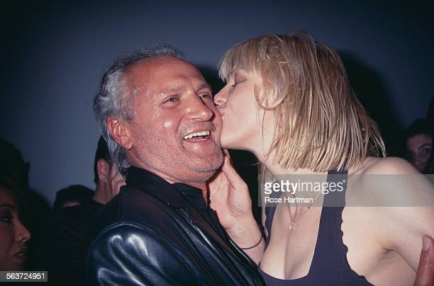 Italian fashion designer Gianni Versace and American singer and musician Courtney Love at the Versus by Versace Fall Collection fashion show circa...