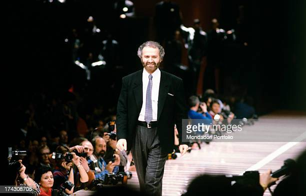 Italian fashion designer Gianni Versace parading on the catwalk after his fashion show 1980s