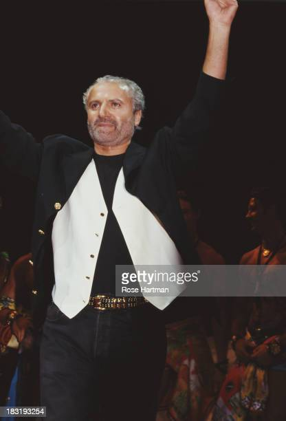 Italian fashion designer Gianni Versace receives applause on the catwalk circa 1996