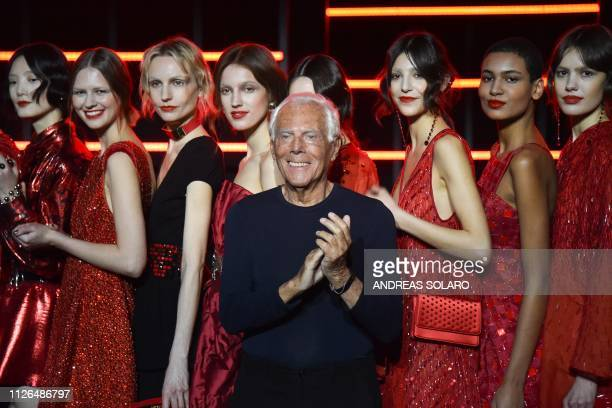 Italian fashion designer Giorgio Armani acknowledges applause following the presentation of the Emporio Armani women's Fall/Winter 2019/2020...