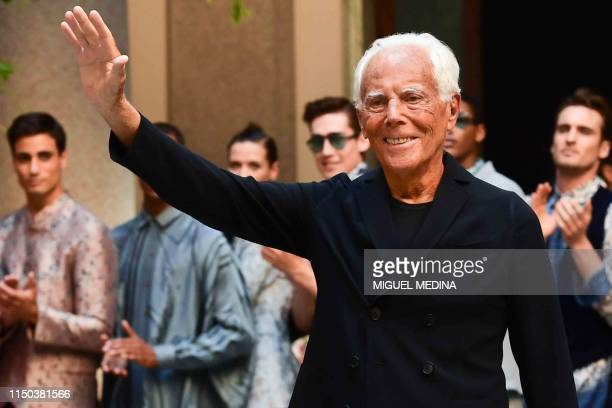 Italian fashion designer Giorgio Armani acknowledges applause following the presentation of fashion house Armani's women's and men's spring/summer...
