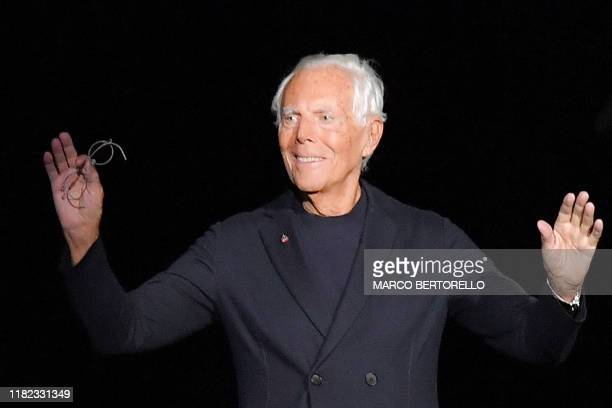 Italian fashion designer Giorgio Armani acknowledges applause following the presentation of his Women's pre-Fall 2020/2021 fashion collection on...