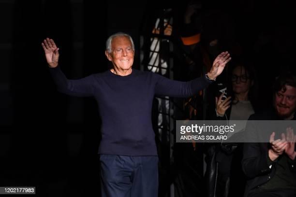 Italian fashion designer Giorgio Armani acknowledges applause following the presentation of Emporio Armani's Women Fall Winter 2020 fashion...