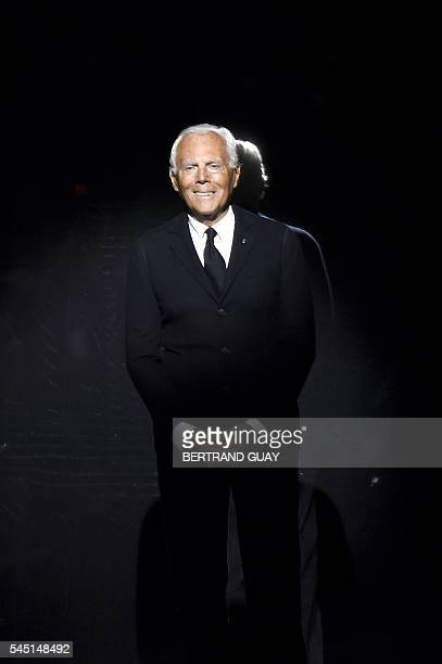 Italian fashion designer Giorgio Armani acknowledges the audience after the Giorgio Armani Prive 2016-2017 fall/winter Haute Couture collection...