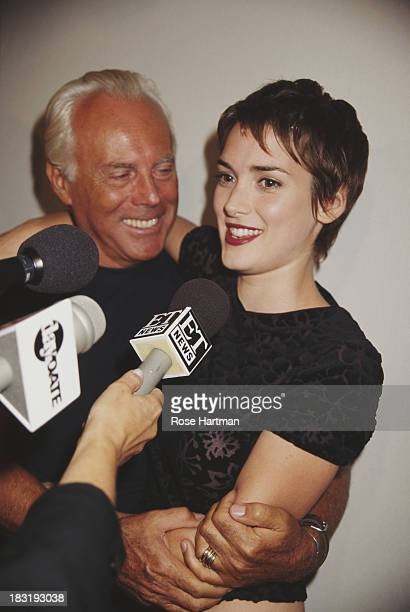 Italian fashion designer Giorgio Armani and American actress Winona Ryder at the Armani party Park Avenue Armory New York City 1996