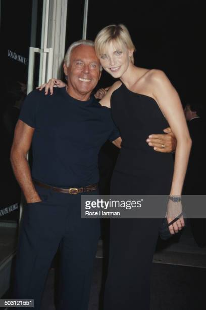 Italian fashion designer Giorgio Armani and German model and actress Nadja Auermann at a Giorgio Armani party being held at the 69th Regiment Armory...
