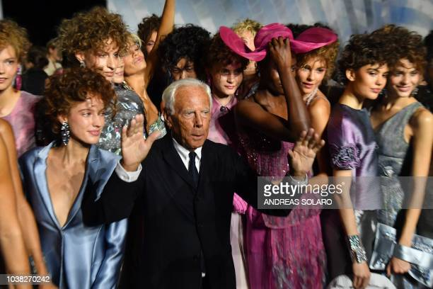 Italian fashion designer Giorgio Armani and models acknowledge applause following the presentation of the Armani fashion show as part of the Women's...