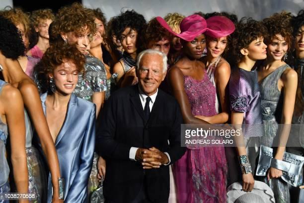 Italian fashion designer Giorgio Armani and models acknowledge applause following the presentation of the Armani fashion show as part of the Women's...