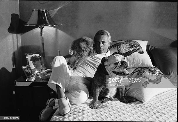 Italian fashion designer Giorgio Armani, born in Piacenza in 1935, with his pets.