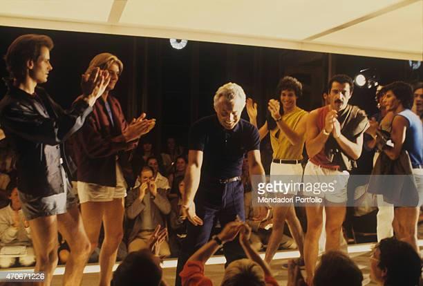 Italian fashion designer Giorgio Armani getting a hand after a fashion show 1970s