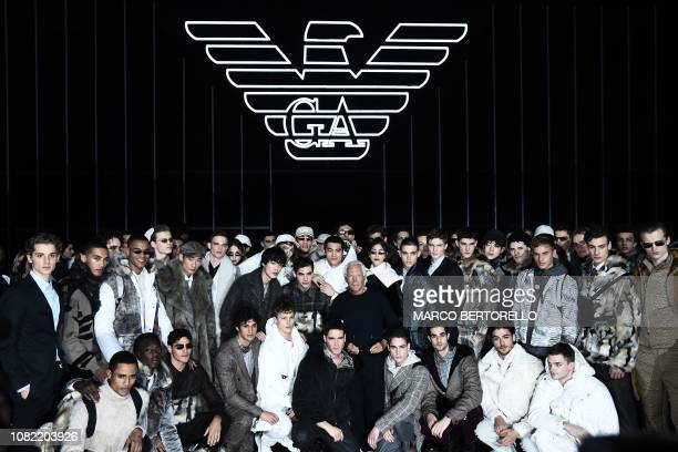 Italian fashion designer Giorgio Armani poses with models following the presentation of the Men's Fall/Winter 2019/20 fashion collection he designed...