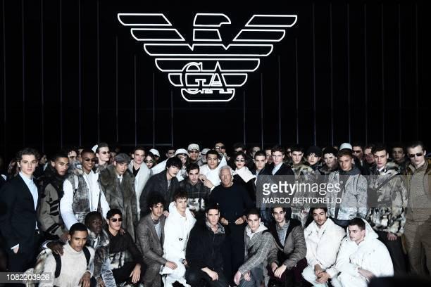 Italian fashion designer Giorgio Armani poses with models following the presentation of the Men's Fall/Winter 2019/20 fashion collection he designed...