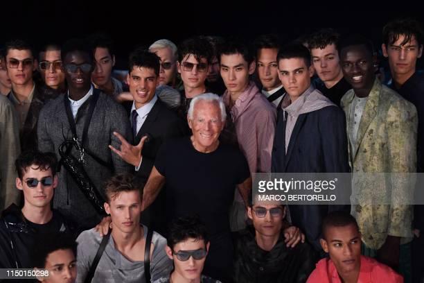 Italian fashion designer Giorgio Armani poses with models following the presentation of Emporio Armani's men's spring/summer 2020 fashion collection...