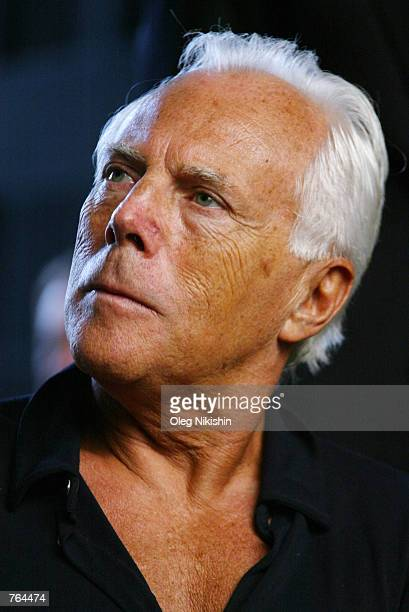Italian fashion designer Giorgio Armani speaks at a news conference about his new collection which will be shown June 18, 2002 in Moscow.