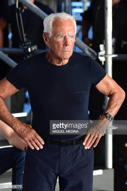 Italian fashion designer Giorgio Armani supervises a rehearsal prior to the presentation of the Emporio Armani fashion house collection as part of...