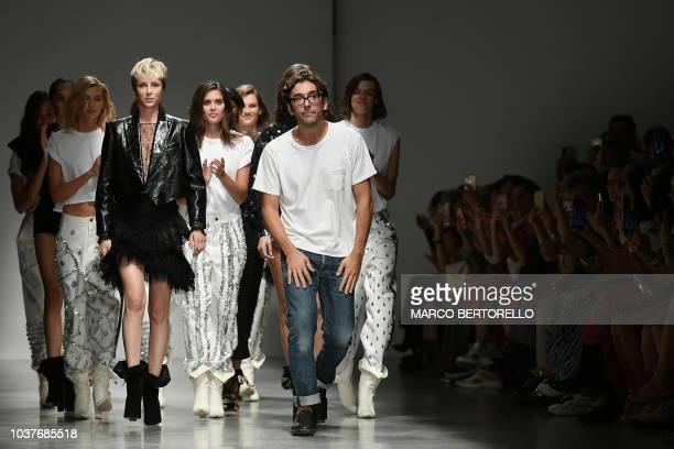 Italian fashion designer Lorenzo Serafini followed by model Edie Campbell acknowledges applause following the presentation of the Philosophy di...