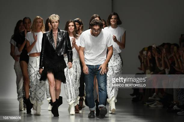 Italian fashion designer Lorenzo Serafini model Edie Campbell and othe rmodels acknowledge applause following the presentation of the Philosophy di...