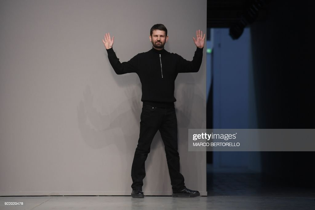Italian fashion designer Lucio Vanotti acknowledges the audience at the end of his women's Fall/Winter 2018/2019 collection fashion show in Milan, on February 21, 2018. / AFP PHOTO / Marco BERTORELLO