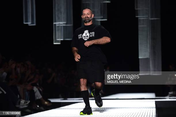 Italian fashion designer Marcelo Burlon acknowledges applause following the presentation of fashion house Marcelo Burlon County of Milan's women's...
