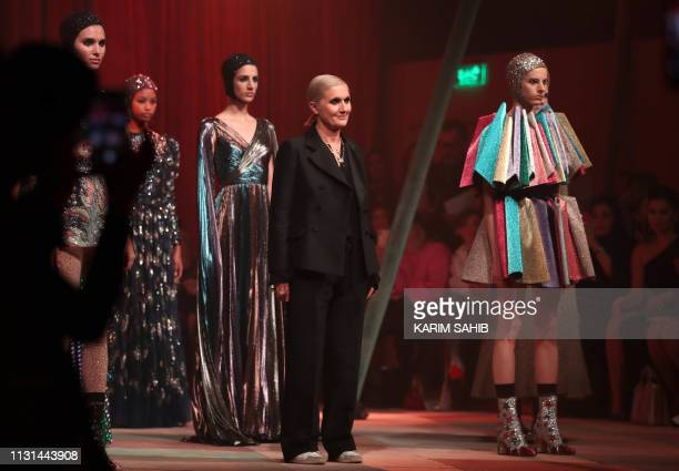 Italian fashion designer Maria Grazia Chiuri acknowledges the audience at the end of the Christian Dior Haute Couture Spring-Summer 2019 collection...