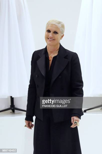 Italian fashion designer Maria Grazia Chiuri for Christian Dior acknowledges the audience at the end of the 20182019 Fall/Winter Haute Couture...