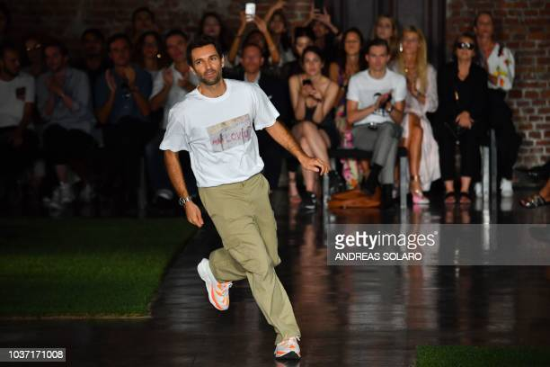 Italian fashion designer Massimo Giorgetti acknowledges applause following the presentation of the MSGM fashion house during the Women's...