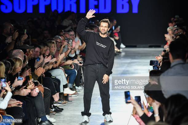 Italian fashion designer Massimo Giorgetti acknowledges applause following the presentation of the MSGM women's Fall/Winter 2019/2020 collection...