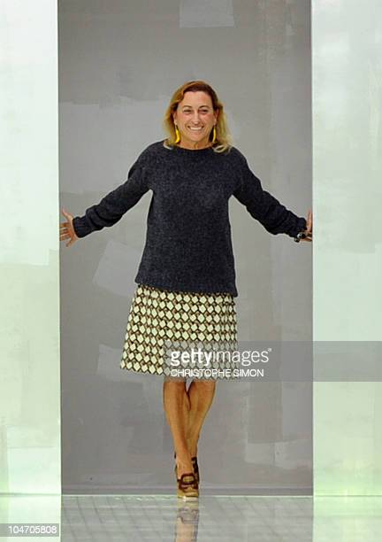 Italian fashion designer Miuccia Prada acknowledges the audience at the end of Prada spring-summer 2011 ready-to-wear collection on September 23,...